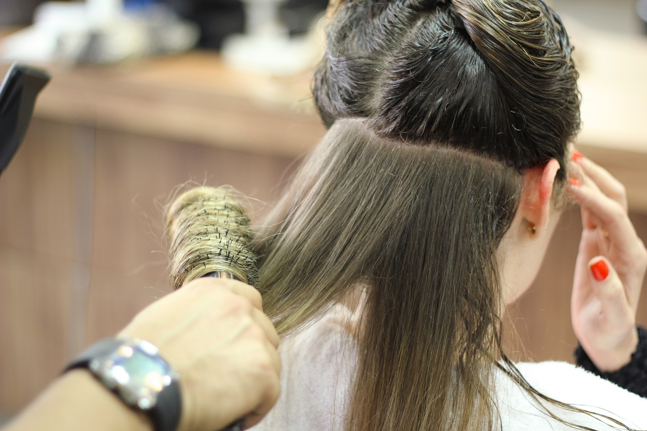 Girl's hair being brushed and combed